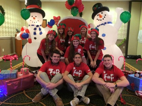 East students help children get into the holiday spirit through FOP party