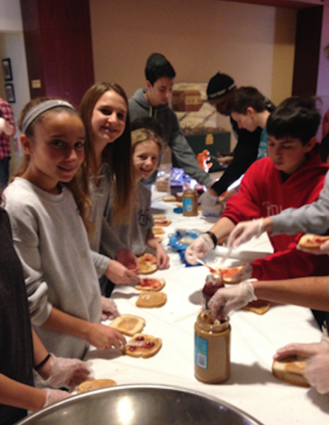 Volunteers from Congregation Beth El make food for those in need.