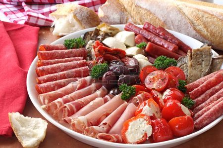 A delicious antipasti platter made with a variety of cheeses and meats.