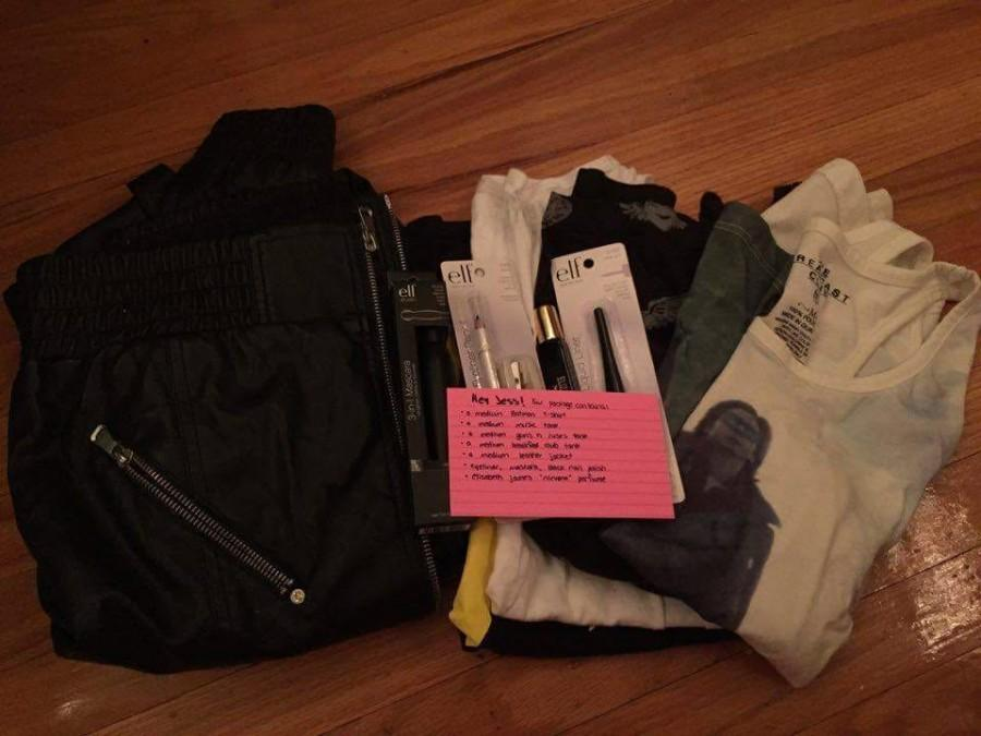 One of Luke's Care Packages consists of female clothing and makeup products with a note addressed to the receiver.
