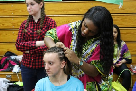 In the DiBart gym, the African American clubs offer to braid students' hair.