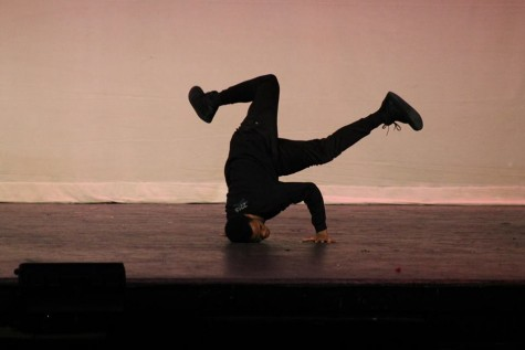 African American club dances to hip-hop and shows off amazing skills on stage.