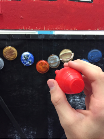 Students aim plastic rockets at one of the nine planets and on the occasion that they hit a planet, the student is awarded a candy bar.